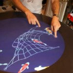 The Grasshopper Round Table, a touch-based game table designed for social play.